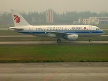 Air China Flight Taking Off. An Air China flight taxiing for takeoff at an airport stock photo