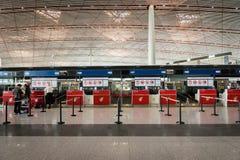 Air China incheckningsdisk på Pekingflygplatsen i Kina Royaltyfri Bild