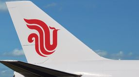 Air China plane, logo close-up. The plane with the Air China company logo is on the blue sky background. The sky area is free for your text stock photography