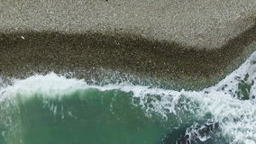 The air coast. Exotic vacation. Waves splash in reefs and roll out onto the shore stock footage