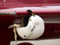 Air combat helmet. Pilot's air helmet on pitot tube on airplane's wing Stock Photos