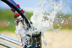 Air compressor clearing water bore Stock Photos