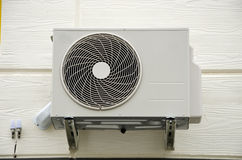 Air compressor fan on  wall Royalty Free Stock Photos