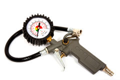 Air compressor gun. With manometer on a white background Royalty Free Stock Photos