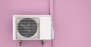 Air compressor on pink wall Stock Image