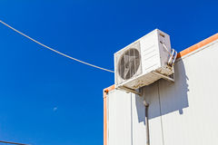 Air compressor is set on the roof of container office Royalty Free Stock Photos