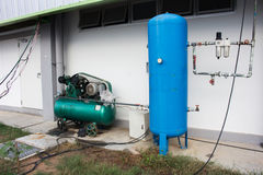 The Air compressor system setup outside the building.  royalty free stock photo
