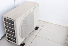 Air compressor unit. Is standing outside the urban building stock images