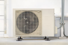 Air compressor. With white wall background royalty free stock photography