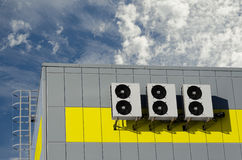 Air compressors installed on industrial building outdoors Royalty Free Stock Photography