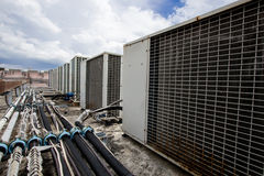 Air compressors on roof of factory Royalty Free Stock Photo