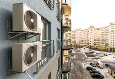 Air condiioners on fasade of reidenial apartmen building. Royalty Free Stock Photos