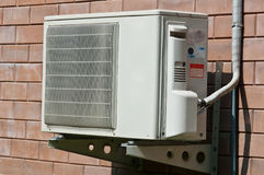 Air condition condenser unit hanging on wall Stock Images