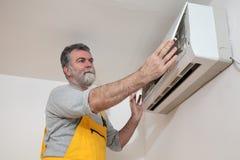Air condition examine or install. Electrician examine or install air condition device in a room stock photos