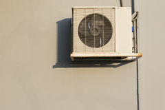 Air condition heating coil handing on building wall Stock Photo