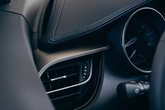 Air condition vent for adjust airflow in a passenger room of car with a circle shape, automotive part concept stock image