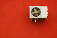 Air conditioner. Device over red wall Stock Photos