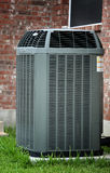 Air conditioner. AC close up on brick wall background Royalty Free Stock Image