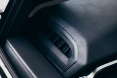 Car conditioner. The air flow inside the car. Detail interior. Air ducts, deflectors on the car panel royalty free stock photography