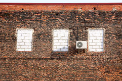 Air conditioner on a brick wall. Royalty Free Stock Photography