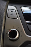 Air conditioner  button. Air conditioner gray button in modern car interior Royalty Free Stock Photography