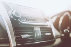 Air conditioner car radio interior listening. changing turning button Radio Stations on Vehicle Multimedia System. Close up Air conditioner car radio interior stock images