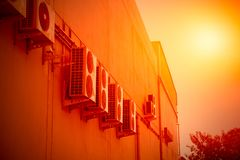 Air conditioner compressor generate heat in hot. Summer season global warming concept royalty free stock images