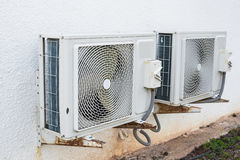 Air conditioner compressor installed in building Royalty Free Stock Photo