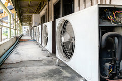 Air conditioner compressor. Installed in old building royalty free stock photos