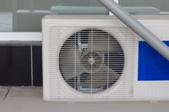Air conditioner compressor installed in old building. Royalty Free Stock Images