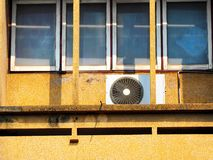 Air conditioner compressor outdoor units. On the terrace of the building stock photos