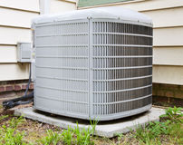 Air Conditioner Compressor. Outside of house Royalty Free Stock Image