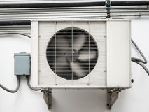 Air conditioner compressor unit. Installed outdoor in the old building stock photography