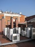 Air Conditioner Compressor Units. Residential Air Conditioner Compressor Units placed on the roof Royalty Free Stock Photos
