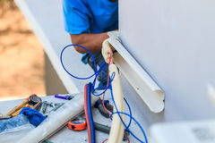 Air conditioner installation process Stock Images