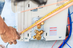 Air conditioner installation process Royalty Free Stock Photos
