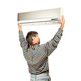 Air conditioner installer. Air conditioning master installing a new air conditioner. Isolated on a white Stock Images
