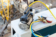 Air conditioner. Installing air conditioner . Vacuum pump royalty free stock photos