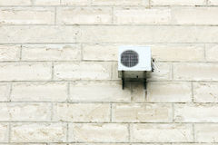 Air conditioner on limestone wall Stock Photography
