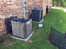 Air conditioner maintenance, cleaning condenser coil. Home maintenance, cleaning air conditioner condenser coils for the compressor unit royalty free stock photos