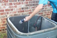 Air conditioner maintenance, compressor condenser coil stock photos
