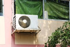 Air conditioner mounted outside the building office stock photos