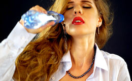 Air conditioner needs repair. Mad woman pours water on breasts. Royalty Free Stock Images