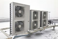 Air conditioner outdoor unit. On winter time stock images