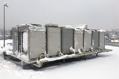 Air conditioner outdoor unit. On winter time stock photos