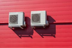 Air Conditioner on red wall background. Cooling Fan Air Conditioner on red wall background Royalty Free Stock Image