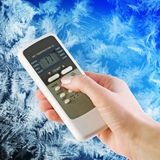 Air conditioner remote control in hand Royalty Free Stock Photos