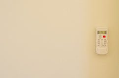Air conditioner remote control on wall background.  Stock Image