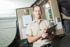 Air Conditioner Repair Man at work Royalty Free Stock Photos