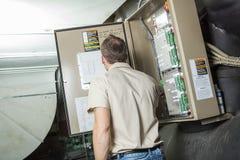 Air Conditioner Repair Man at work Royalty Free Stock Image